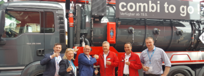 Celebrating CountyClean Group's latest major equipment deal at iFAT on 15th May 2018 with a hearty handshake in front of one of KROLL's combination tank units. From left: CountyClean Group – Trevor Beer, Operations Director; Debbie Walker, Director & Owner; Mike Walker, Managing Director and Owner. KROLL Fahrzeugbau- Umwelttechnik GmbH – Jens Skowronnek, Managing Director; Sven Schepler, Head of Sales & Marketing. For O'C Mechanical Services – Damien O'Connor, Director.